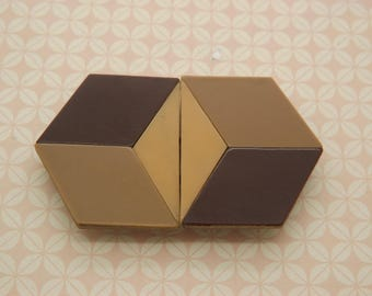 A beautiful pure Art deco geometric design antique belt buckle in carved shades of brown bakelite