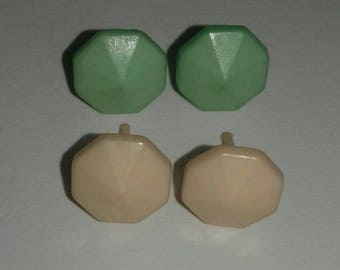 Two pairs of small plastic stud earings.