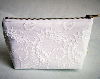 "7"" ""Euphoria"" White embroidered cotton gusseted pouch w/ brass zipper, lavender lining"
