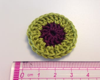 Rosette plum and green crocheted flower