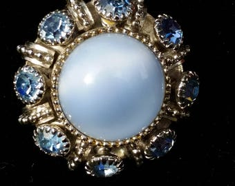 Avon Silver Tone Blue Moonglow and Rhinestone Accent Circle Pendant 24 Inch Necklace - Vintage, Made in 1974