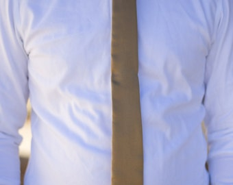 Solid gold skinny tie