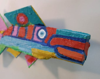 Fish Art Created from from wood found in the woods or on beaches around the world. Each completely unique fish is painted with imagination