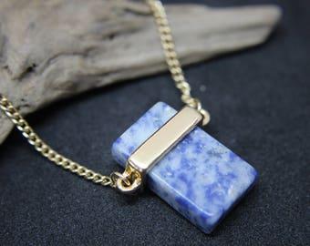 Natural stone in gold on chain quartz