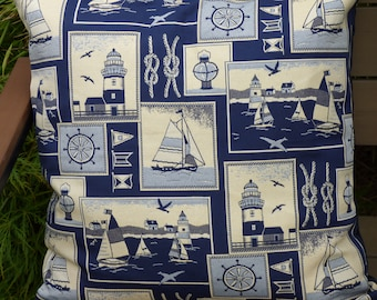 Sailing design cushion cover. Blue and cream nautical themed cushion cover, knots,wheel, yacht, lighthouse. Plain blue back with zip