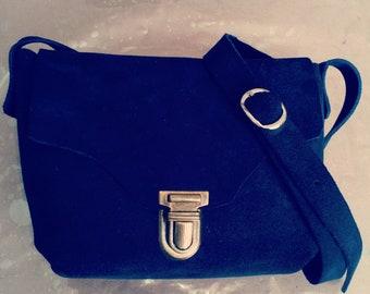 small blue shoulder bag