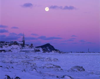 Full moon at sunrise in winter at Cap-Chat,his village, the church, the ice  and his lighthouse, Gaspe Coast