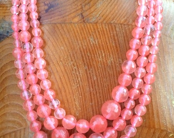 "Watermelon Stone Faceted Round Beads, a graduated 17 1/2"" strand."
