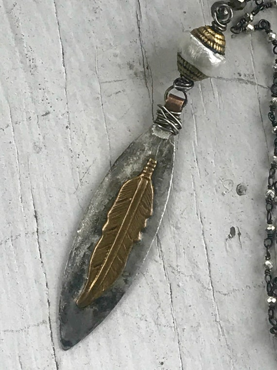 Pluma.  Feather pendant on delicate pyrite chain. Handmade and one of a kind by ladeDAH! Jewelry.