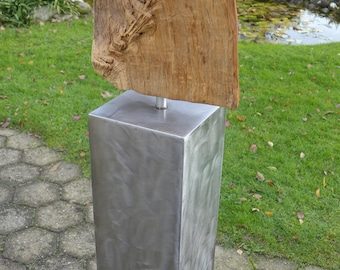 Steel column with super piece of metal, partly gold leaf