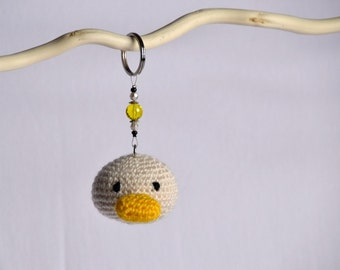 Handmade crochet duck charming amigurumi toy key ring, cute animal, excellent gift or personal accessory or party favor.