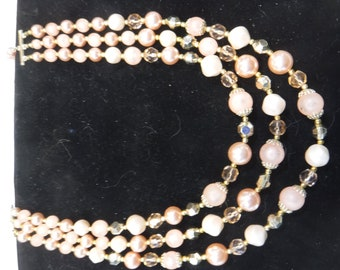 Three strand peach and gold necklace