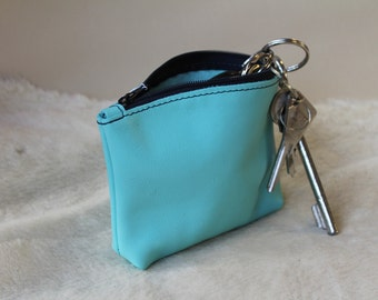 change purse; coin purse. Blue change purse; Blue zip purse (ET.26)