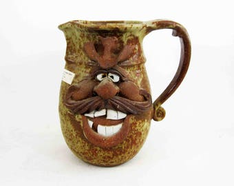 Vintage Stoneware Pottery Face Pitcher by Robert Eakin. Circa 1970's.