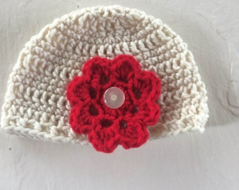 Crocheted baby hat with 1 detachable flower
