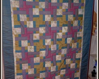 Plaid patchwork quilted entirely by hand