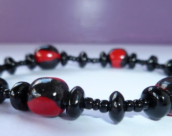 Black with a Touch of Sparkly Red Bracelet