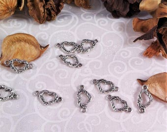 8 small connectors heart silver and decorated, length 16 mm