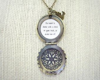It's Hard To Dance with A Devil on Your Back Handcrafted Brass Locket Necklace with Bird Charm