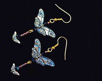 Blue Butterfly earrings... fluttering around your cheeks to bring you smiles and happy thoughts.