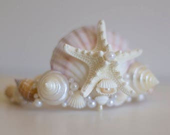 Ivory and white bridal mermaid crown featuring large central ivory and pale pink scallop shell, starfish, cockle shells and beading.