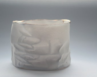 White with gold vessel. Crumpled paper-looking vessel made out of fine bone china with real gold