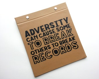 Running Bib Holder - Adversity can cause some to break and other to break records  - Gifts for Runners - Race Bib Book Light Brown Black