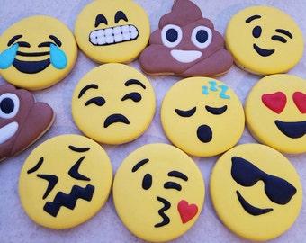 One dozen emoji cookies
