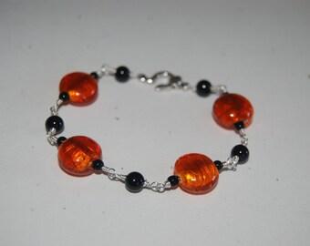 Artistic Wire Wrapped Orange Black Glass Bracelet