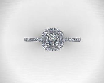 Elegant sterling silver half carat princess cut cubic zerconia halo engagement ring .