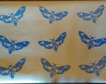 Hand printed Death Head Moth on recycled wrapping paper