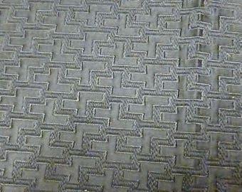 Black canvas with geometric patterns