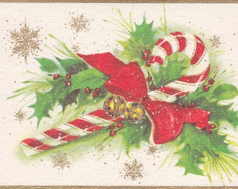 Unused 1960s Christmas card with a candy cane and holly theme