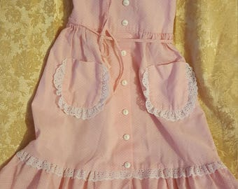 Summery vintage pink childs' sundress with white pink polk-a-dots