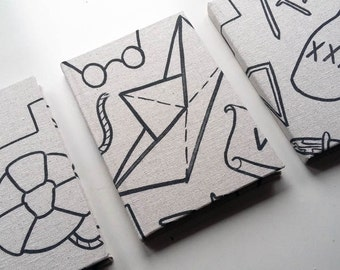 Fabric covered notebook, in a pattern inspired by classic tattoo flashes // Original printed fabric // Customised A5 notebook //