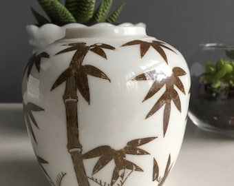 Vintage brown and white ginger jar with bamboo stalks