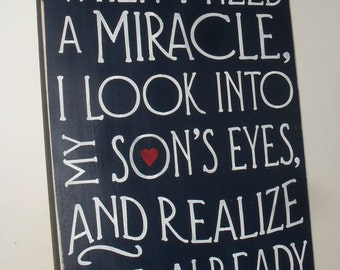Sometimes When I Need A Miracle I Look Into My Son's Eye's And Realize I Created One Typography Inspirational Sign