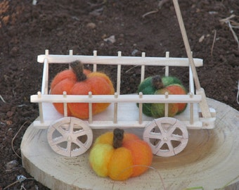 Needle felted pumpkins with hay wagon