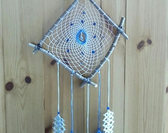 Dream catcher with lace frills, blue and white feathers