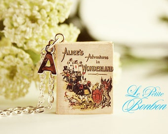 Alice in Wonderland story book with initial necklace
