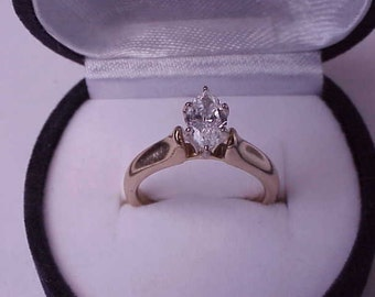 14k  Yellow Gold   .80ct Diamond ( E Color extremely rare and expansive, emits unrivaled brilliance!) Ring ,Appraisal Certificate Included!!