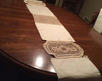Table runner made from vintage linen and lace.