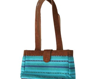 Small turquoise leather bag
