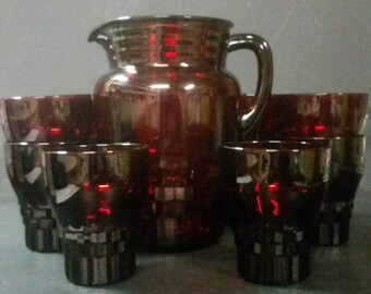 Vintage ruby red pitcher and 10 matching glasses.