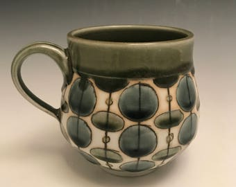 Handmade wheelthrown porcelain mug in olive green and gray dots