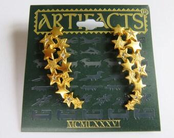 JJ Jonette Gold Tone Cascading Stars With Rhinestone Centers Pierced Earrings