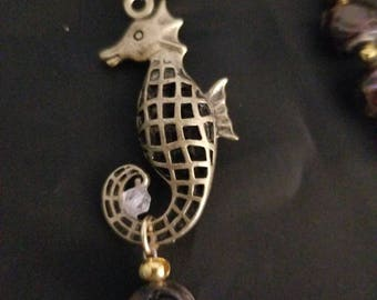 Seahorse and cultured pearls