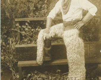 Handsome man dressed as cowboy antique rppc photo