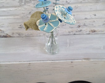 carolina blue button flower bottle bouquet