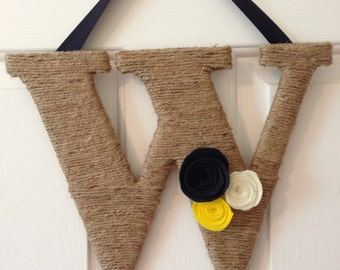 Jute wrapped letter W, with Navy, Ivory and Yellow felt flowers and Navy ribbon.